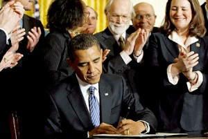 """Barack Obama Signing The Petition"""