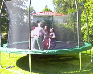 """My husband, my daughter, a friend and I jumping on the trampoline"" in our garden - It was fun"