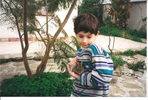 """Little Andrew holding a rabbit -  Sicily - Christmas 1996"""