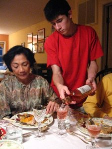 """""""Thanksgiving 2006 - Andrew refilling a friend's glass"""""""