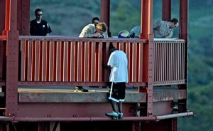 "Luckily this young man is talked out of ""jumping off the Golden Gate Bridge"" by a California Highway Patrol officer"