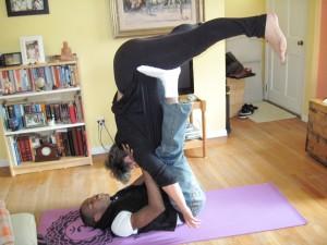 """Akil & I practicing """"Acro Yoga"""""""