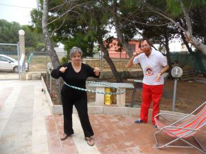 "Marausa, Sicily. May 24, 2011 - Esmeralda with her ""Hoopnotica Hula Hoop"" and Andrea with... not sure"