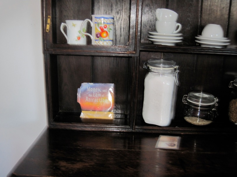 Abraham-Hicks' CD, Moneu and the Law of Attraction, on a shelf in my Kitchen